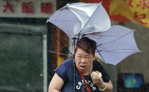 Image Of A Woman Eating Pork Bun During A Typhoon Goes Viral